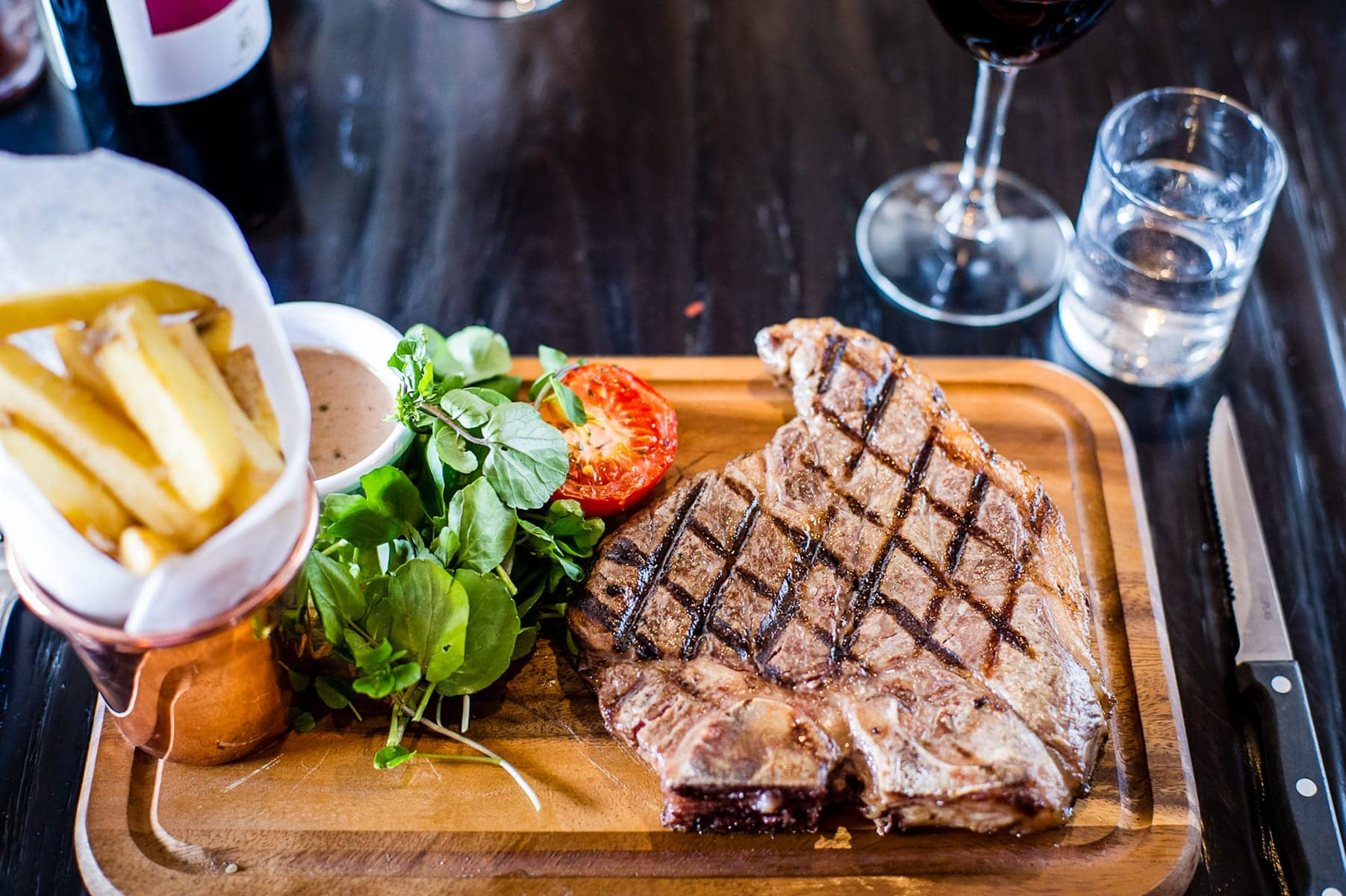 Steak and food on a board at The Riverside Bar & Restaurant Cambridge
